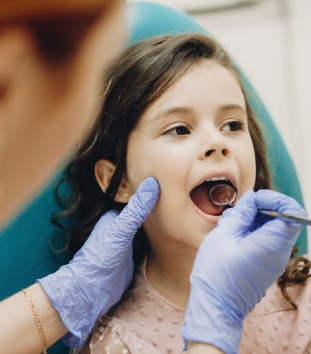 Young girl receiving dental checkup