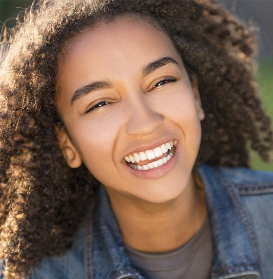 Preteen girl with metal free dental restorations