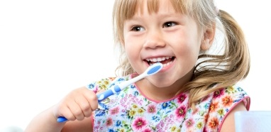 Child brushing teeth at preventive dentistry appointment
