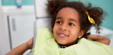 Smiling young girl at restorative dentistry appointment